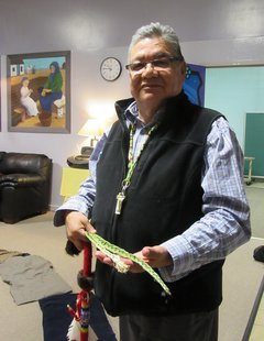 Wally Awasis holds traditional sweetgrass